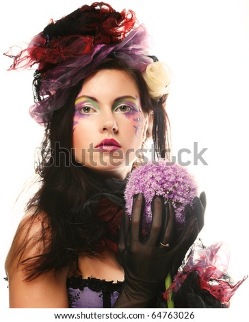 young woman with creative make-up in doll style with flower - stock photo