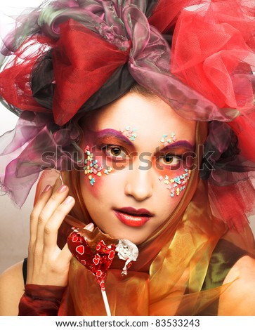 Young woman with creative make-up with chocolate heart