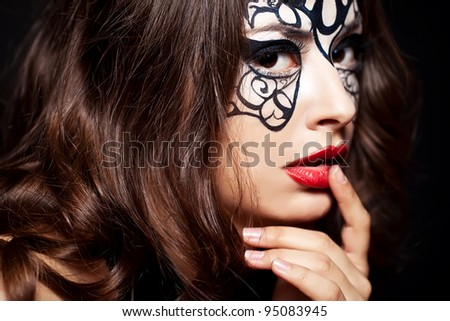 Young woman with creative makeup - stock photo