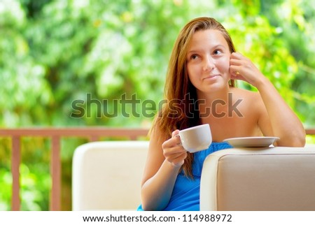 Young woman with cup of coffee.