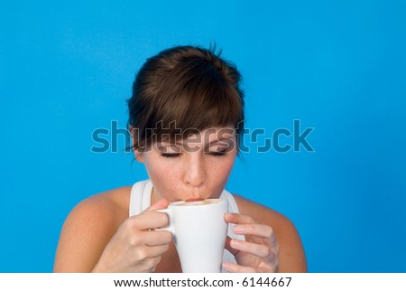 young woman with cup of coffee - stock photo