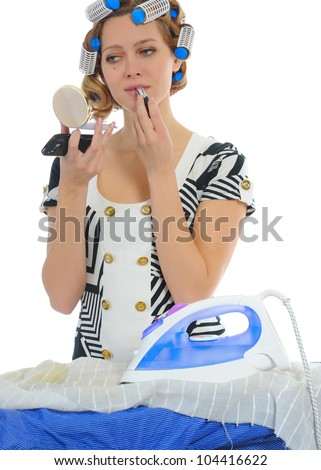 Young woman with curlers on her head stroking men shirt makes makeup.  Isolated on white background - stock photo
