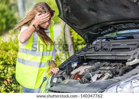 Young Woman with Damaged Car - stock photo