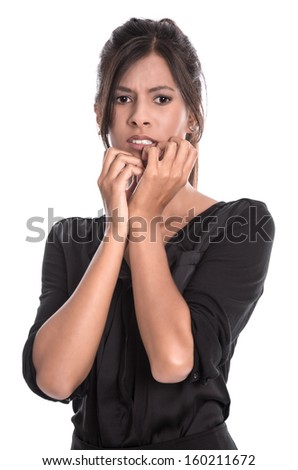 Young woman with dark hair in a black shirt is very panic and have fear - isolated - stock photo