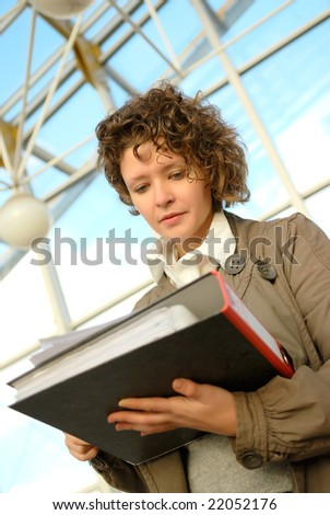 Young woman with documents binder