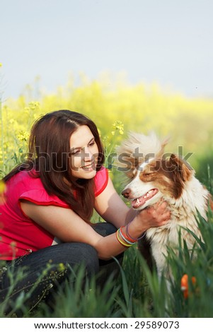 Young woman with dog outside. - stock photo