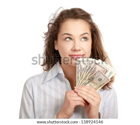Young woman with dollar notes in her hand. Isolated on white background. - stock photo