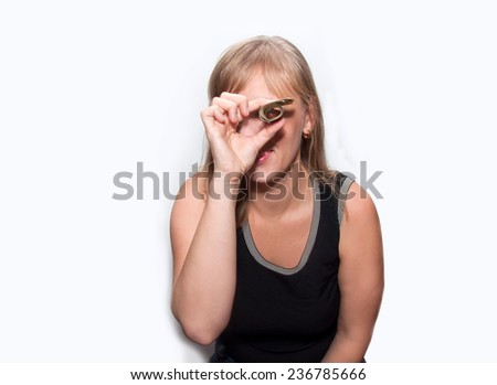 Young woman with dollars in hands smiles isolated - stock photo