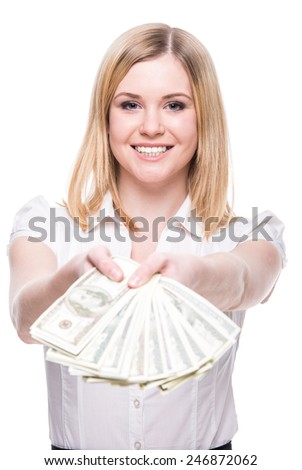 Young woman with dollars in her hands, isolated on white background. - stock photo
