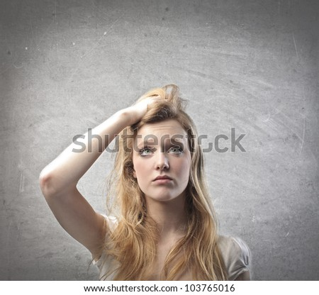 Young woman with doubtful expression - stock photo