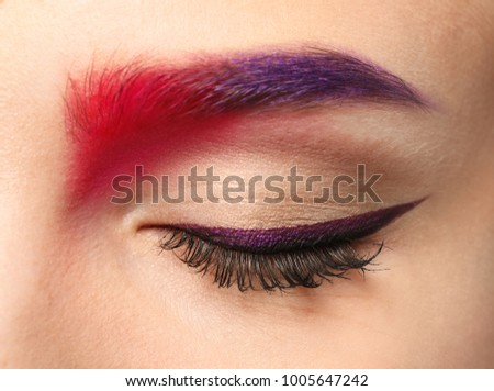 Young woman with dyed eyebrow, closeup