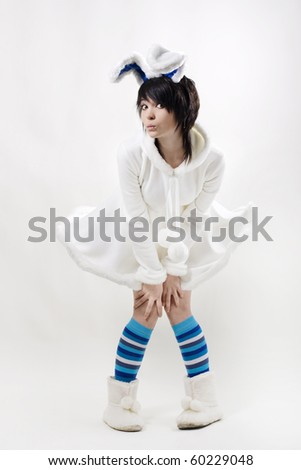 Young woman with east bunny ears - stock photo