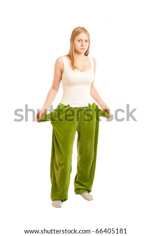 young woman with empty pockets holds baby - stock photo