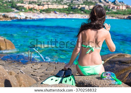 Young woman with equipment ready for snorkeling  - stock photo