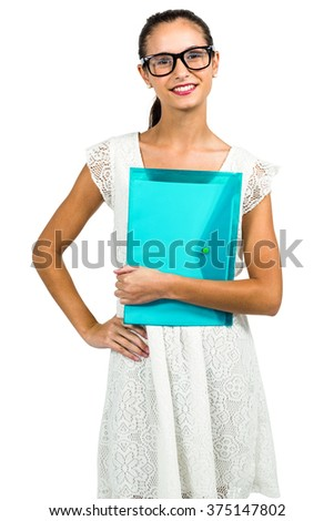 Young woman with eyeglasses holding plastic folder on white screen - stock photo