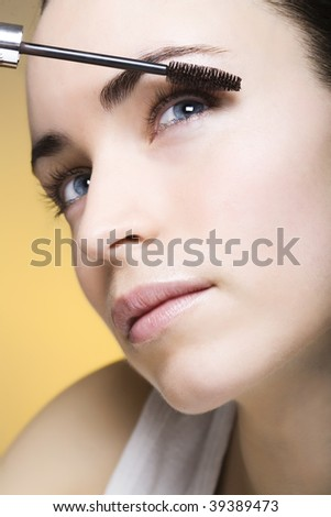 young woman with eyeliner for her eyelashes - stock photo