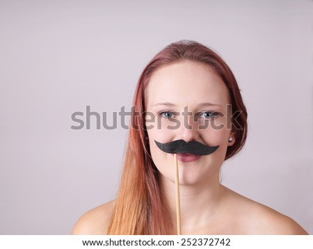 young woman with fake mustache  - stock photo