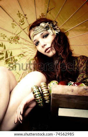 young woman with fashion accessories and  parasol portrait - stock photo