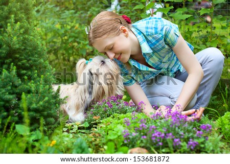 Young woman with favorite dog. - stock photo