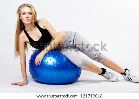 Young  woman with fit-ball, isolated over white background