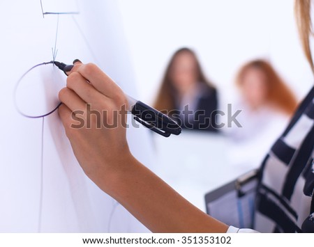 Young woman with folder  writing on board - stock photo