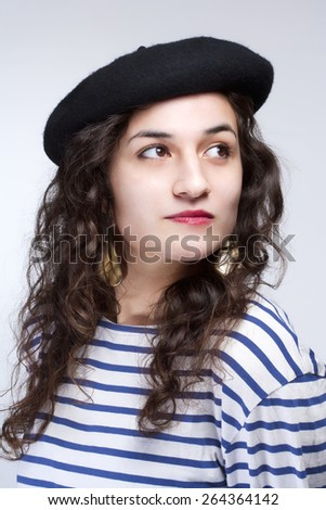 Young Woman with French Style Beret Hat and Striped T-shirt - stock photo