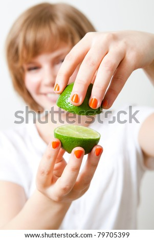 Young woman with fresh lime. Studio shot.