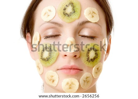 Young Woman with Fruit Mask on Her Face - stock photo