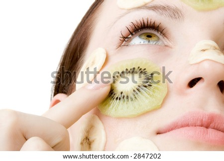 Young Woman with Fruit Mask on Her Face