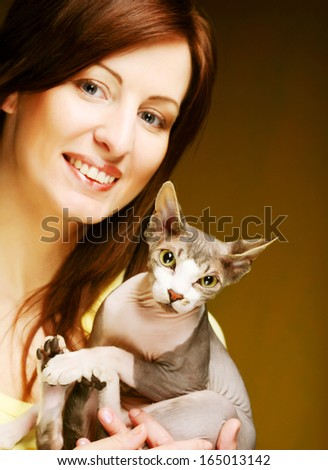 young woman with fun sphynx  cat - stock photo