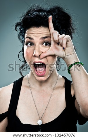 Young Woman with Funny Expression over a Grey Background - stock photo