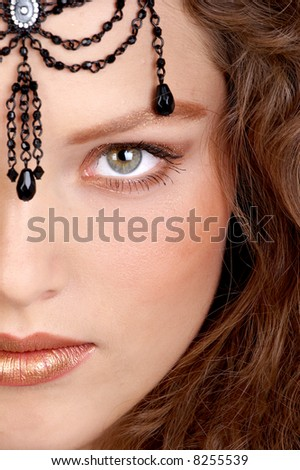 Young woman with gem. Close up.