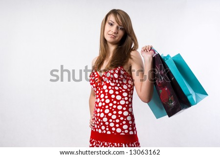 Young woman with gift bags