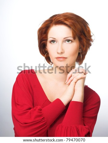 Young woman with ginger hair in red dress