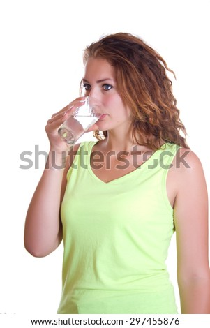 Young woman with glass of water drinks, studio shot, isolated, profile. - stock photo