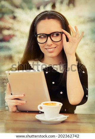 Young Woman with Glasses and Tablet Having Coffee - Beautiful woman with glasses on a coffee break with her tablet