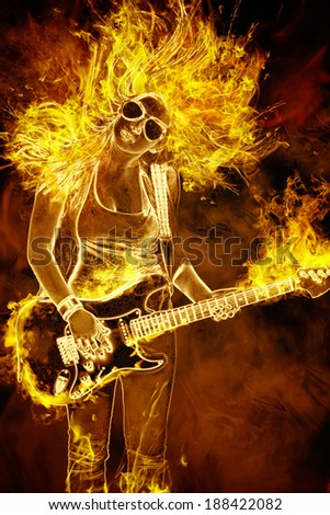 young woman with guitar in fire flames on black background - stock photo