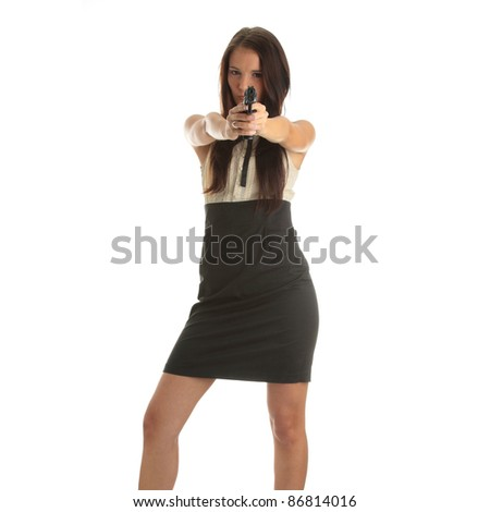 Young woman with hand gun isolated on white background