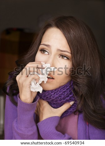 Young woman with handkerchief having  cold. Isolated. - stock photo