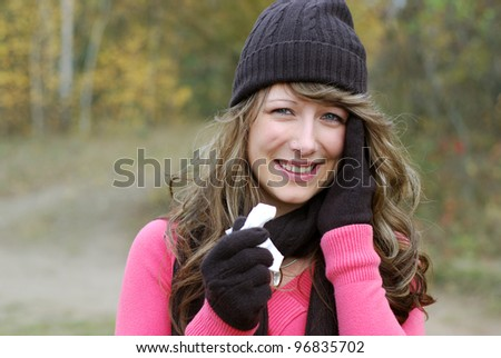 young woman with handkerchief outdoors in autumn