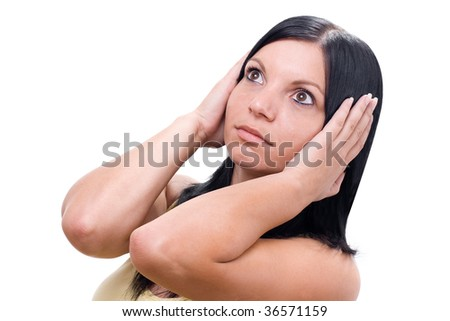 young woman with hands holding ears on white - stock photo