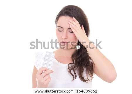 young woman with headache showing package of tablets isolated on white background - stock photo