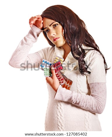 Young woman with headache take pills and tablets. Isolated. - stock photo