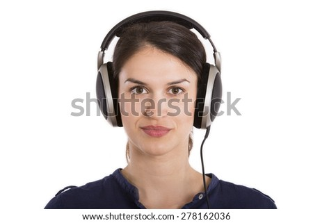 young woman with headphones looking at camera