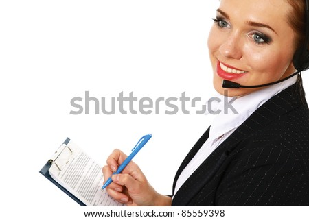 Young woman with headset making notes over white background - stock photo