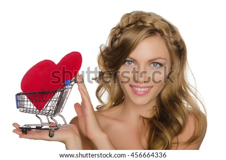 young woman with heart in shopping cart isolated on white