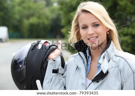 Young woman with helmet for motorcycle - stock photo