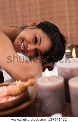 Young Woman With Her Eyes Closed Relaxing In A Spa - stock photo