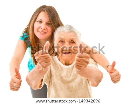 young woman with her grandmother showing thumbs up on an isoltad backgroundq - stock photo