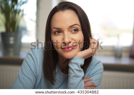 young woman with her head on her hand - stock photo